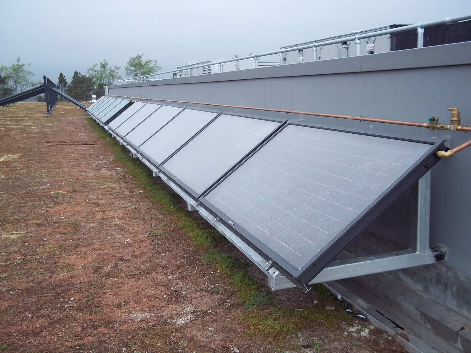 12 x Flat Plate Solar Thermal Collectors generating hot water for changing room showers